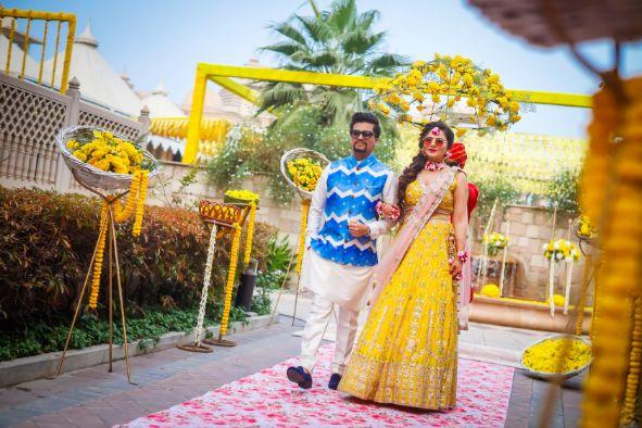 pool side wedding | indian wedding pool side | destination wedding outside delhi | haldi ceremony | floral decoratioms | indian parents and bride | realwedding | indian bride and groom Kitsch mehendi decor