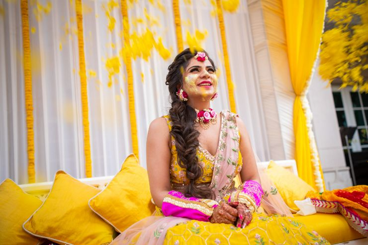 flower shower for indian brides | twirling bride in lehenga , yellow lehenga | #wittyvows #indianbrides pool side wedding | indian wedding pool side | destination wedding outside delhi | haldi ceremony | floral decoratioms | indian parents and bride | realwedding |