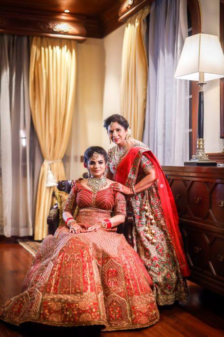 mother daughter | indian  bride in red lehenga |  Kitsch mehendi decor  Kitsch mehendi decor