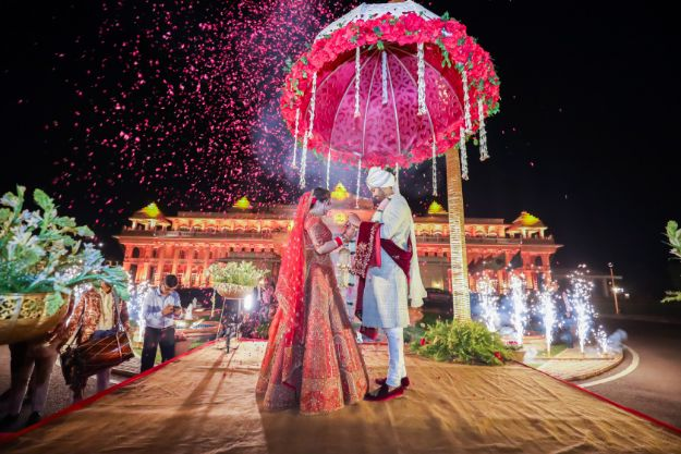 wedding couple indian bride in red lehenga | Kitsch mehendi decor | destination wedding