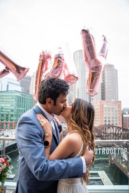sealing it with a kiss | propose on roof top