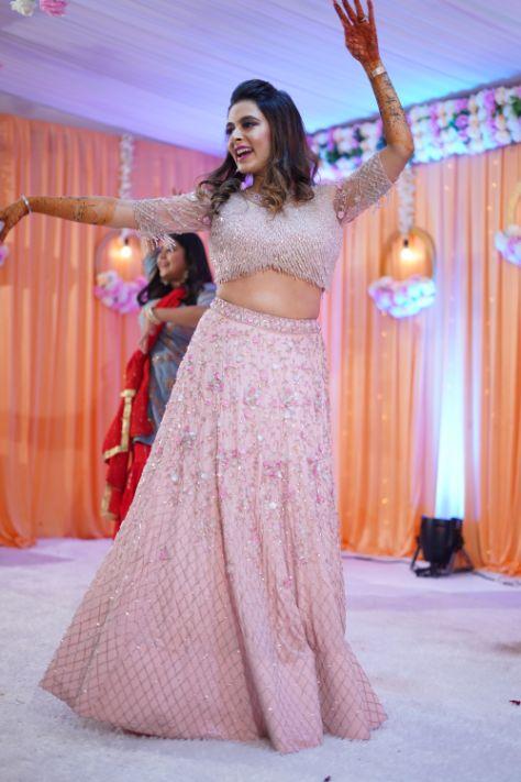 indian bride dancing in her sangeet ceremony