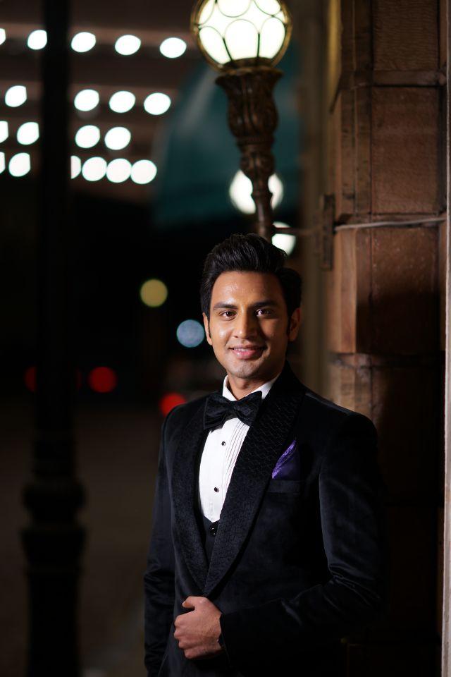 dashing groom in black tuxedo