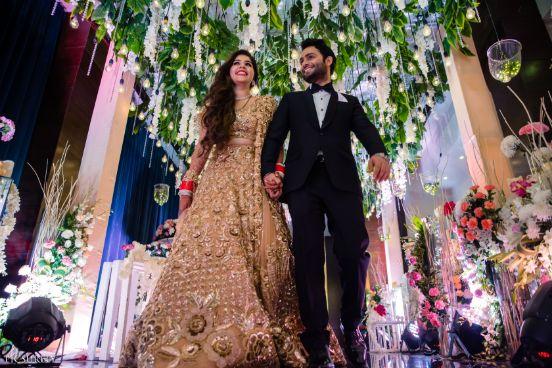 indian couple holding hands | indian wedding Mumbai wedding | Manish Malhotra Lehenga  reception Outfit  | chooda designs  indian couple |  #wittyvows #indianwedding