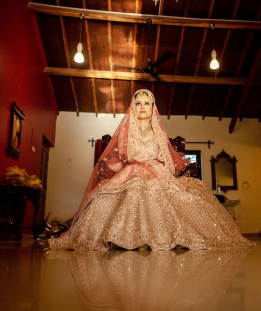 indian bride in pastel pink lehenga for her wedding day