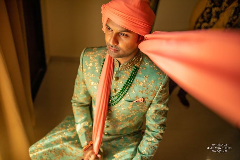 groom in pastel green sherwani for his wedding day