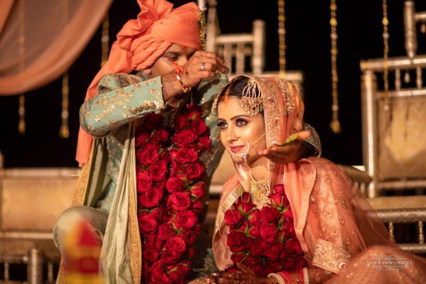 indian wedding rituals | stunning red roses varmala