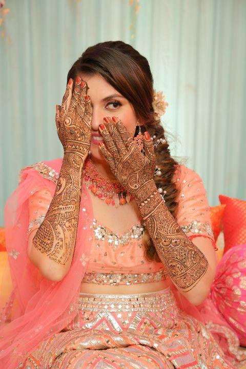 mehendi photoshoot | bridal henna design | mehendi outfits | indian wedding mehendi scene | mehendi designs | green sabyasachi lehenga | chomu palace | floral wedding