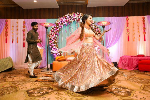 mehendi outfits | indian wedding mehendi scene | mehendi designs | green sabyasachi lehenga | chomu palace | floral wedding
