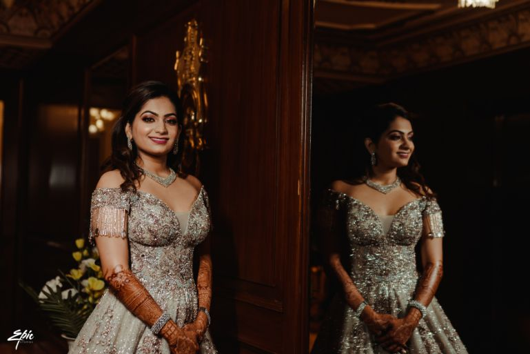 bride to in stunning gown for ring ceremony