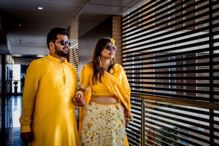 candid photography , couple wedding moments , haldi ceremony