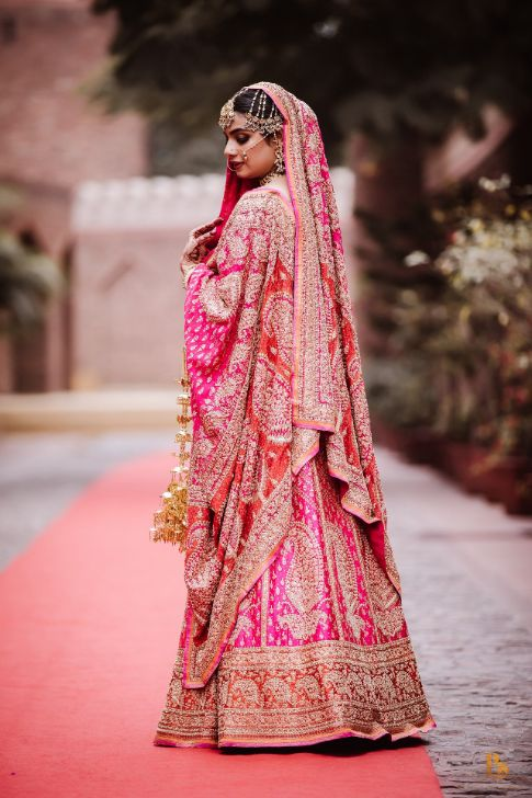 indian bridal lehenga in pink , indian bride in pinklehenga , chooda designs , Punjabi bride | Mehendi outfit | bridal lehenga | Indian veil