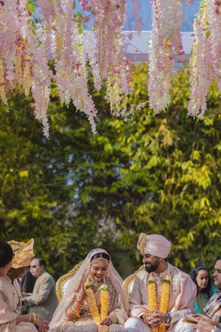happy couple , sabyasachi bride