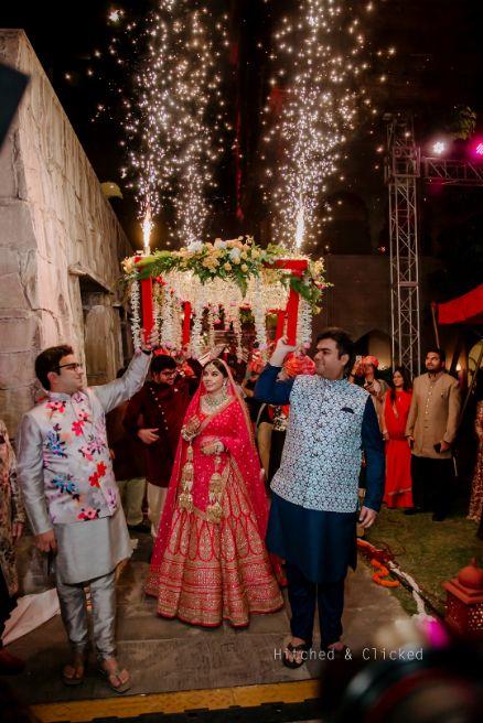 indian bridal wedding entry   sabyasachi bride , sabyasachi lehenga , red bridal lehenga , wedding decor , indian wedding   decor ideas for weddings , destination wedding , wedding at Fairmont, Fairmont Jaipur, Mehendi decor ideas, wedding entry