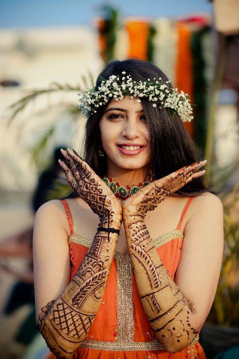 happy bride | brides in shades | mehendi look | henna designs | bridal seat in flowers | summer wedding | delhi wedding