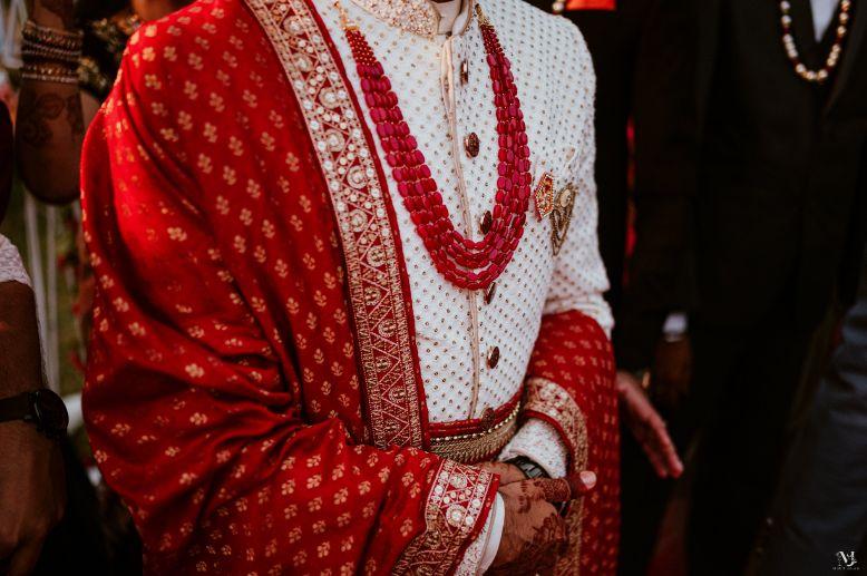 bridal details , indian groom , bridal portrait , red lehenga , couple kissing , indian groom , Rajasthani wedding | DIY lehenga design | Bridal hairdo | footear | boss bride customised | wittyvows real wedding |