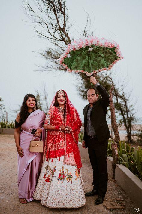 bridal portrait , red lehenga , couple kissing , indian groom , Rajasthani wedding   DIY lehenga design   Bridal hairdo   footear   boss bride customised   wittyvows real wedding  