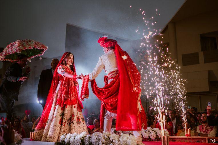 couple kissing , indian groom , Rajasthani wedding | DIY lehenga design | Bridal hairdo | footear | boss bride customised | wittyvows real wedding |