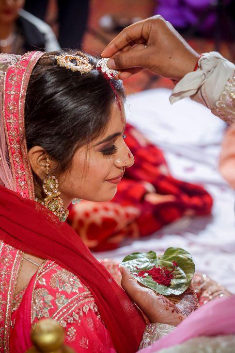 saath phera moment   inidnan birdal portrait   red lehenga   red chooda   delhi wedding , summer wedding , mehendi look