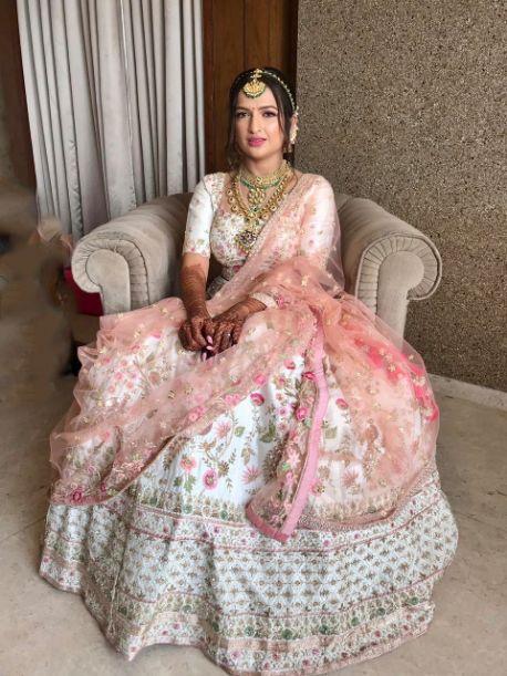 indian bridal outfit lehenga designs , bride hairstyle , floral hairstyle , indian wedding , indian bride , indian groom , hairstyle ideas, bridal hairdo