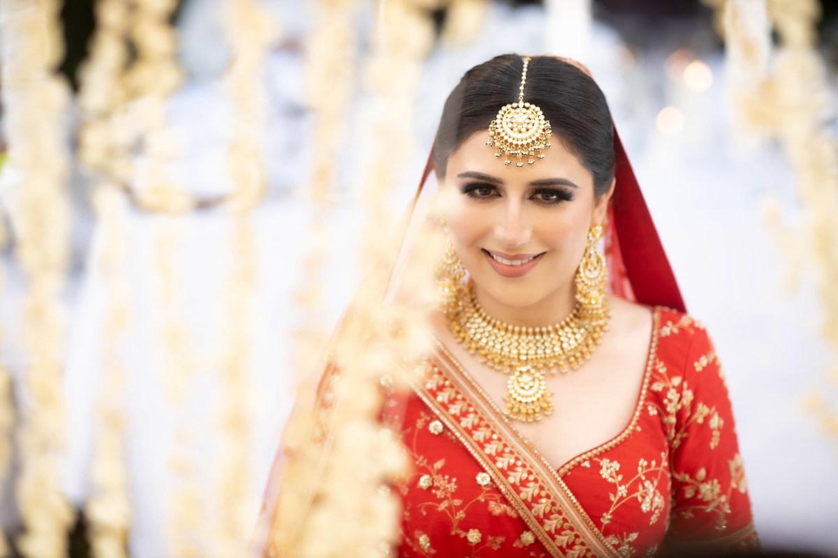 Black and white , bridal bun , couple , wedding couple , sabyasachi bride , red lehenga , wittyvows , real weddings 2020 , Red Sabyasachi lehenga and phoolon ki chadar