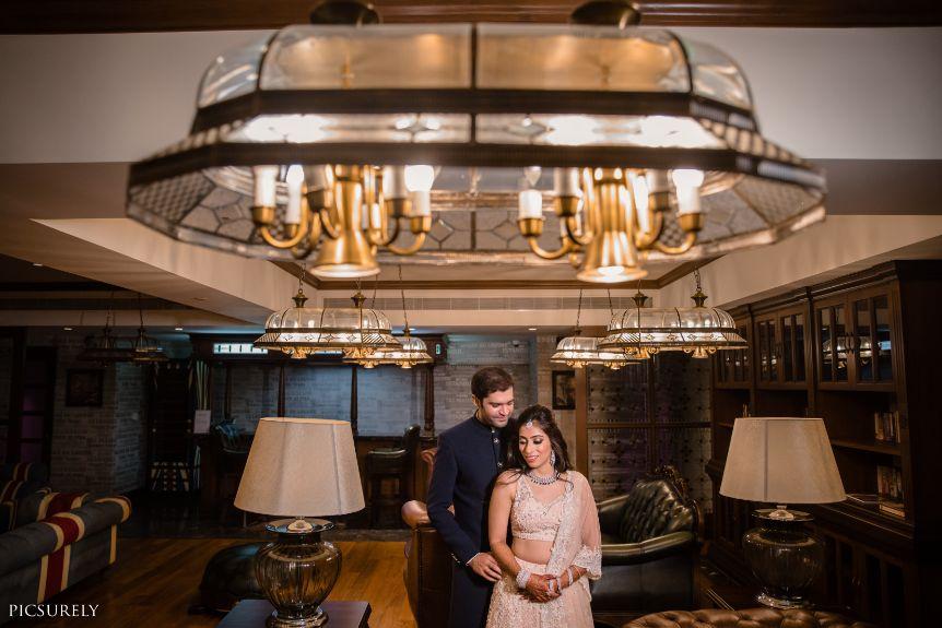red lehenga , couple photoshoot , red chooda , wittyvows , indian bridesmaid , indian groomsmen , destination wedding | wedding in Goa | beachside mandap | mehndi look