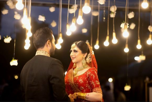 couple , wedding couple , sabyasachi bride , red lehenga , wittyvows , real weddings 2020 , Red Sabyasachi lehenga and phoolon ki chadar