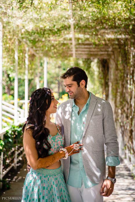 mehendi look , beachside mehendi , red lehenga , couple photoshoot , red chooda , wittyvows , indian bridesmaid , indian groomsmen , destination wedding | wedding in Goa | beachside mandap | mehndi look