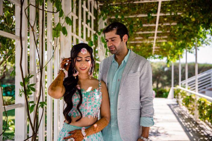 indian couple wedding candid , short lehenga , indian wedding , india bride , wittyvows , weddings , goa wedding , destination wedding   wedding in Goa   beachside mandap   mehndi look ,mehndi