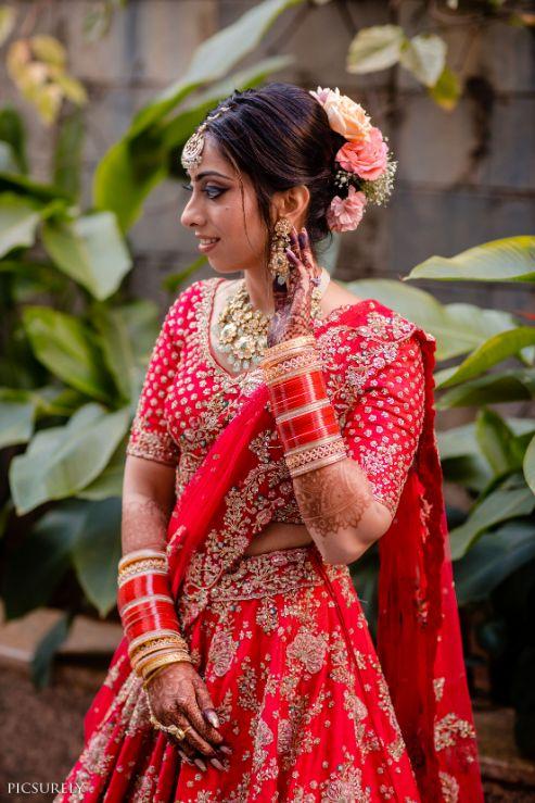 red lehenga , wittyvows , indian weddings , indian bride , red chooda , goa wedding ,