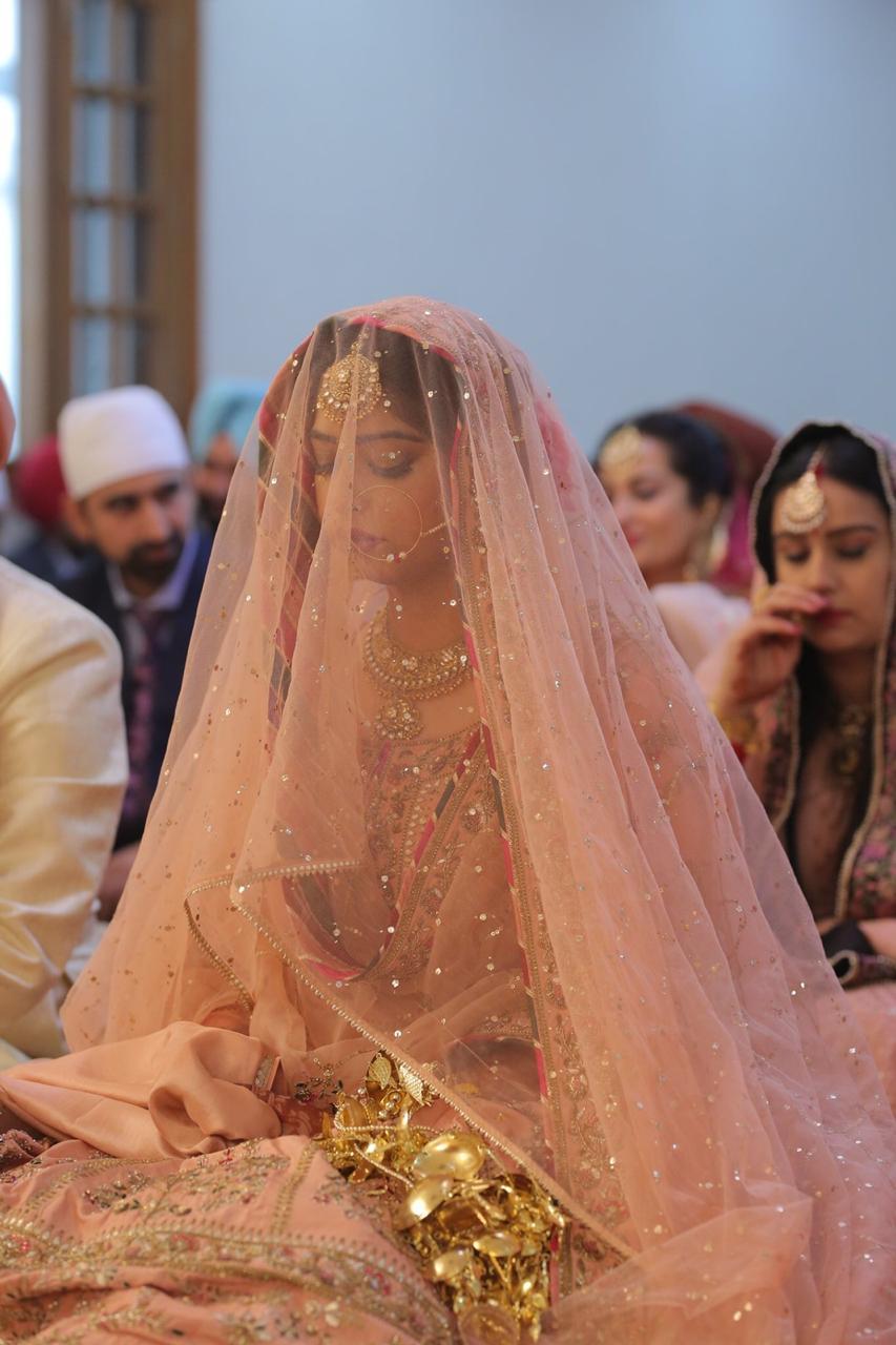 bridal veil , bridal dupatta on head , indian couple , sikh wedding , wittyvows , anandkaraj lehenga | personalised embroidery | bridal dupatta | punjabi wedidng
