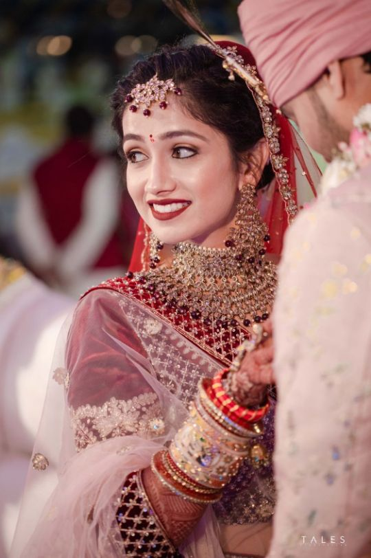 bridal looks , wedding look , red lehenga , bridal mehendi , floral hands , floral jewellery , intimate wedding, personalised wedding ideas