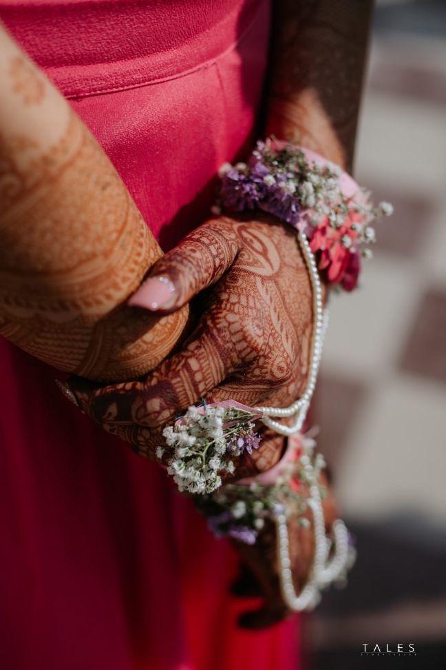 bridal mehendi , floral hands , floral jewellery , intimate wedding, personalised wedding ideas