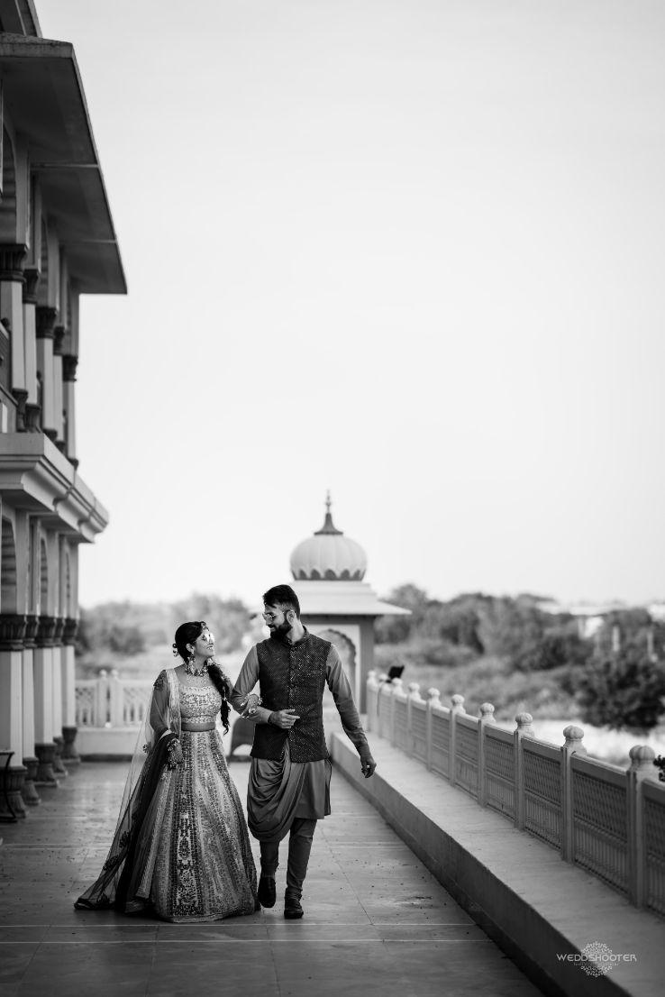 couple photoshoot , balck and white indian bridal entry , dancing bride , Destination wedding \ wedding in Jodhpur | Colourful mehendi ideas