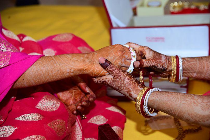 henna hands , mehendi bengali bride , wittyvows , indian wedding , indian wedding 2020 , small weddings , real bengali wedding , Bengali wedidng | traditional wedding | wedding details