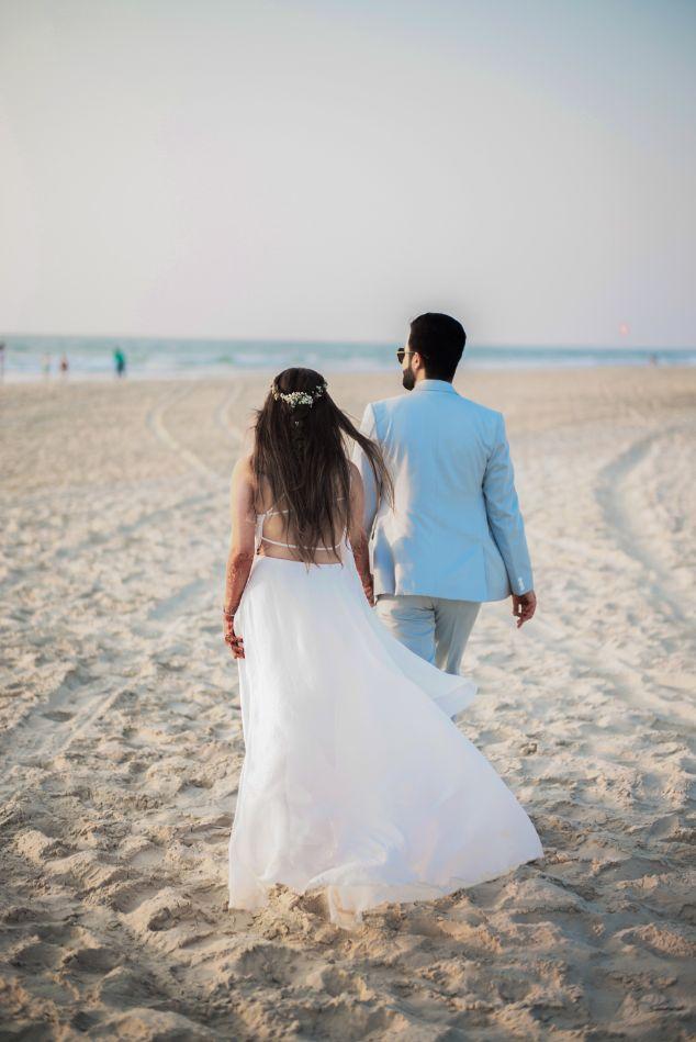 goa wedding , beach wedding couple hand holding , all white , destination weddings , wittyvows , wedding blog Beach wedding   wedding in Goa   cocktail outfit   beach party
