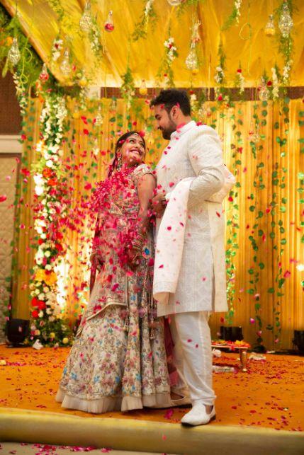 indian bridal lehenga , indian wedding cake , pastel wedding, grand wedding cake Chandelier cake, wittyvows , wedding blog , indian couple