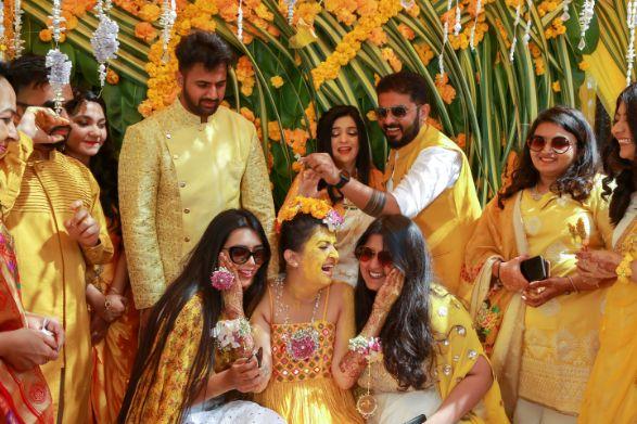 haldi moment , bride with her tribe , haldi shower , wittyvows , gaurav gupta gown , Indian bride , weddings , big fat indian wedding , red lehenga , sabyasachi bride indian destination wedding , lakeside wedding | wedding in hua hin | bridal entry in a boat