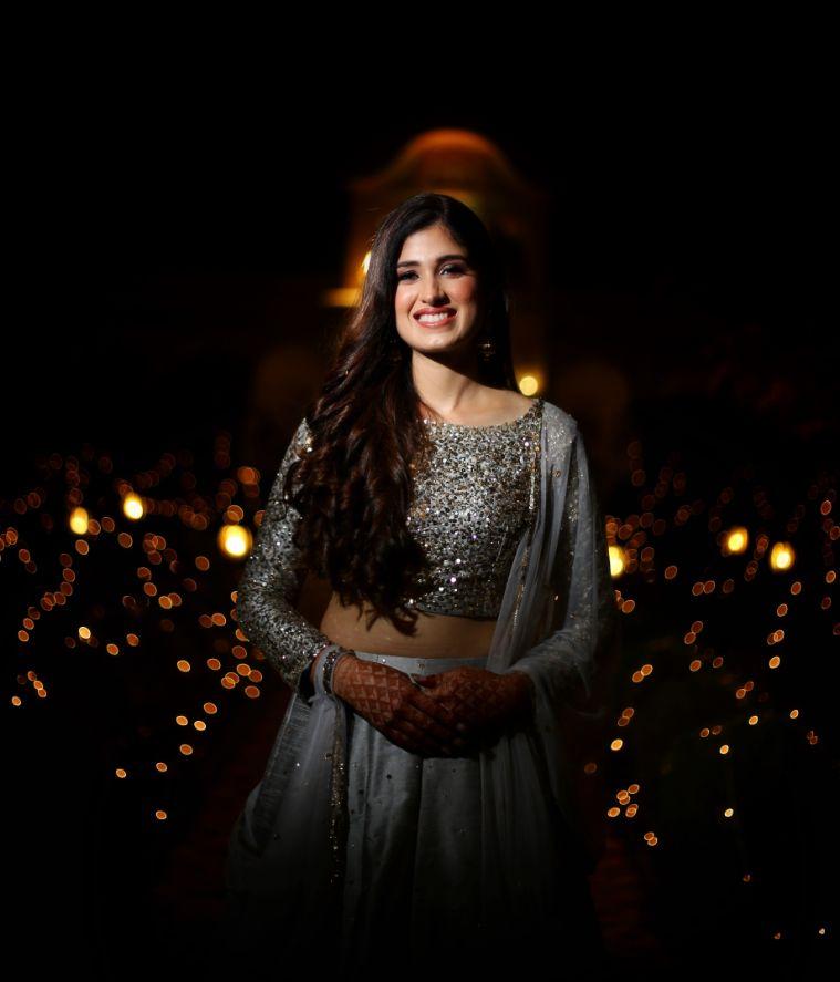bride in beautiful silver lehenga and open hair