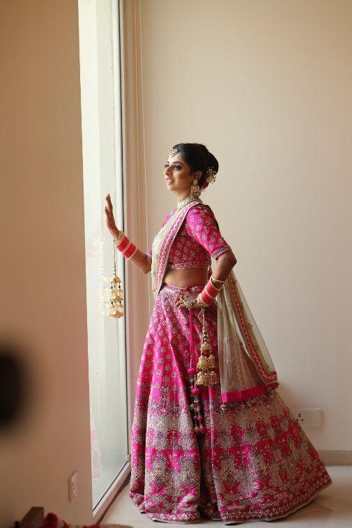 indian bride hetting reday poses   Pink Anita Dongre Lehenga