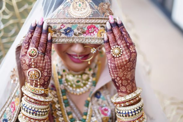 stunning bridal henna | hand harness for the bride | bridal veil shots | Beach Wedding in Alibaugh