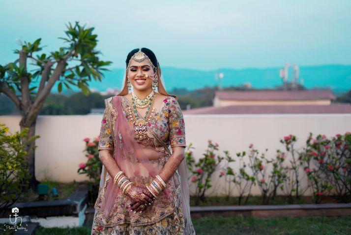 happy bride | pastel pink lehenga with phulkari work | Beach Wedding in Alibaugh