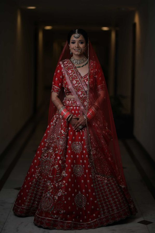 red lehenga , bridal lehenga , bridal portraits , indian bridal wear , indian wedding , pastel wedding , SEO - cross culture wedding  | couple outfits | bridal jewellery