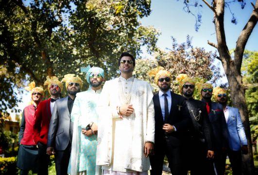 groom poses with groomsmen