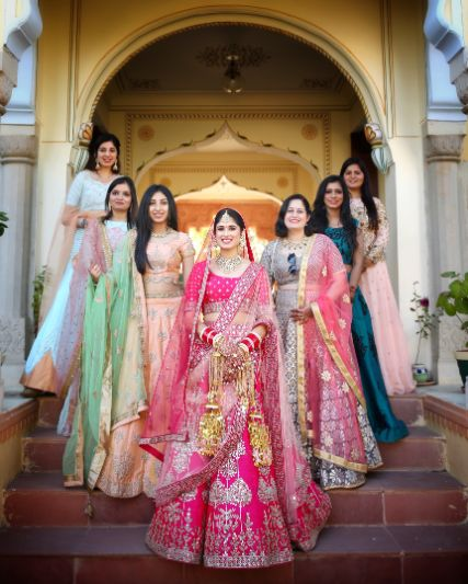 bride posing with her beautiful bridesmaids