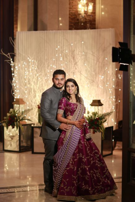 indian wedding decor   bride in purple lehenga
