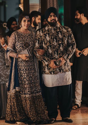 beautiful couple wearing matching outfits | Sparkling Red Gown for the Cocktail
