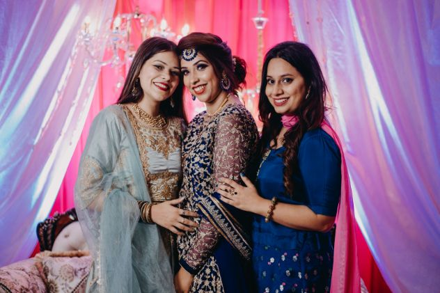 photo with bridesmaids | indian wedding diaries | Sparkling Red Gown for the Cocktail