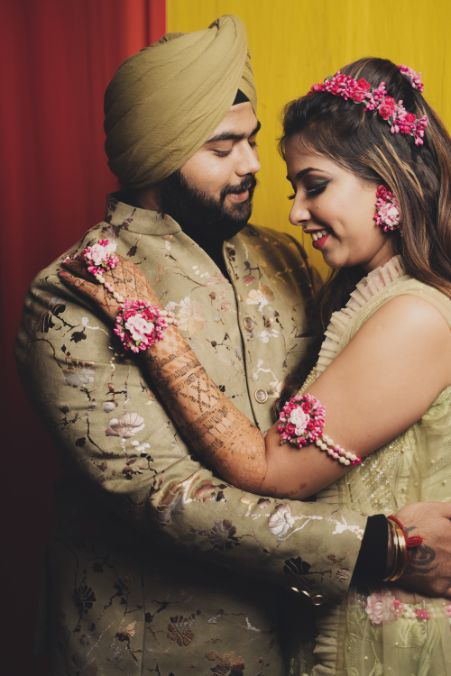 couple wearing matching outfits | mehendi ceremony |