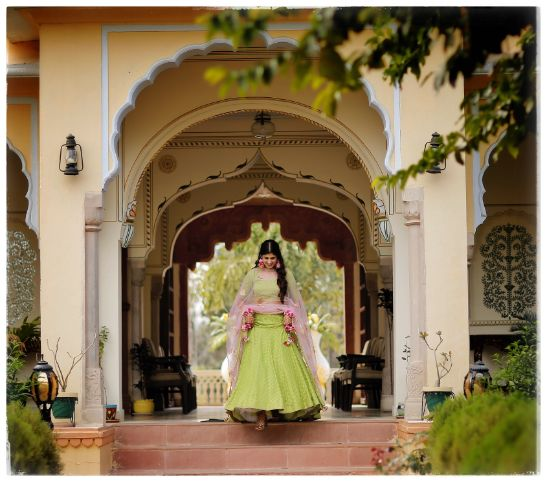 bride in beautiful green lehenga  | Wedding in  Orchha with a Reception Lehenga to Drool Over